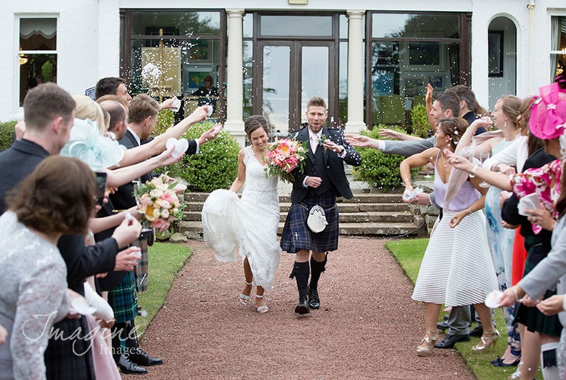 Bride and Groom showered in confetti on wedding day at Lochgreen House Hotel, Ayrshire
