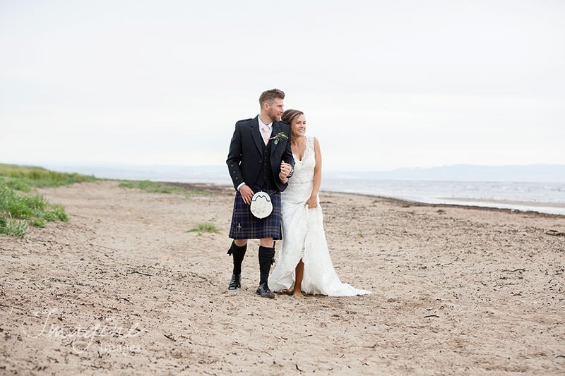 Bride and Groom together at Troon beach on their wedding day at Lochgreen House Hotel, Ayrshire