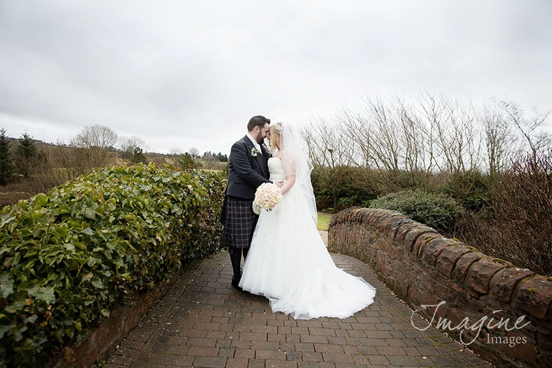 Bride and Groom on wedding day at Lochside House Hotel in Ayrshire