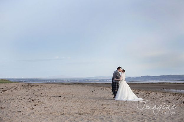 Bride and Groom on wedding day at Troon beach
