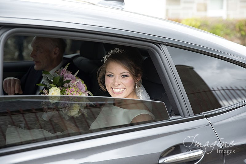 Bride arrives for wedding day in car