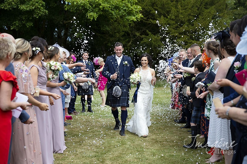 Bride and Groom showered with confetti at Shiledhill Castle