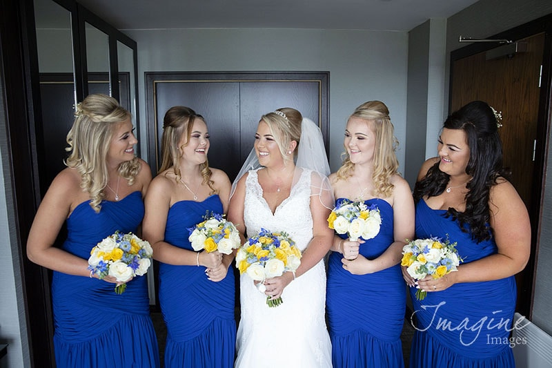 Bride with bridesmaids on wedding day at Lodge on Loch Lomond