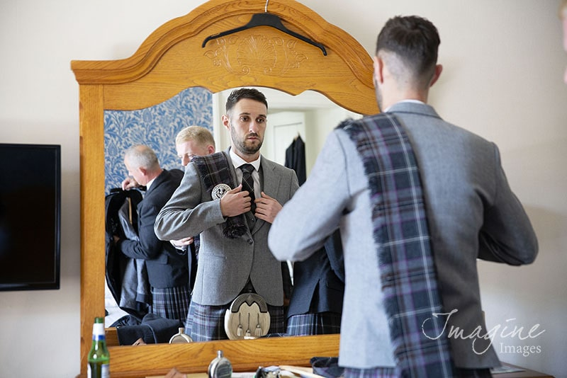 Groom preparations on wedding day at Cornhill Castle