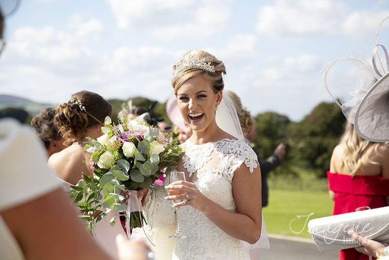 Smiling bride on wedding day at Cornhill Castle