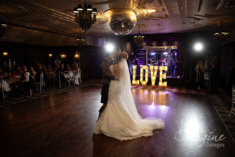 Bride and Groom during first dance on wedding day at Cornhill Castle