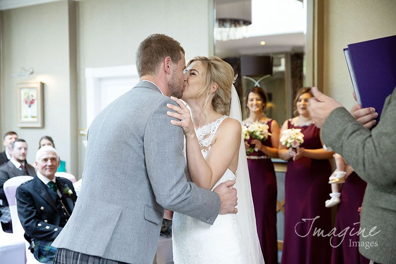First kiss on wedding day at Balbirnie House Hotel