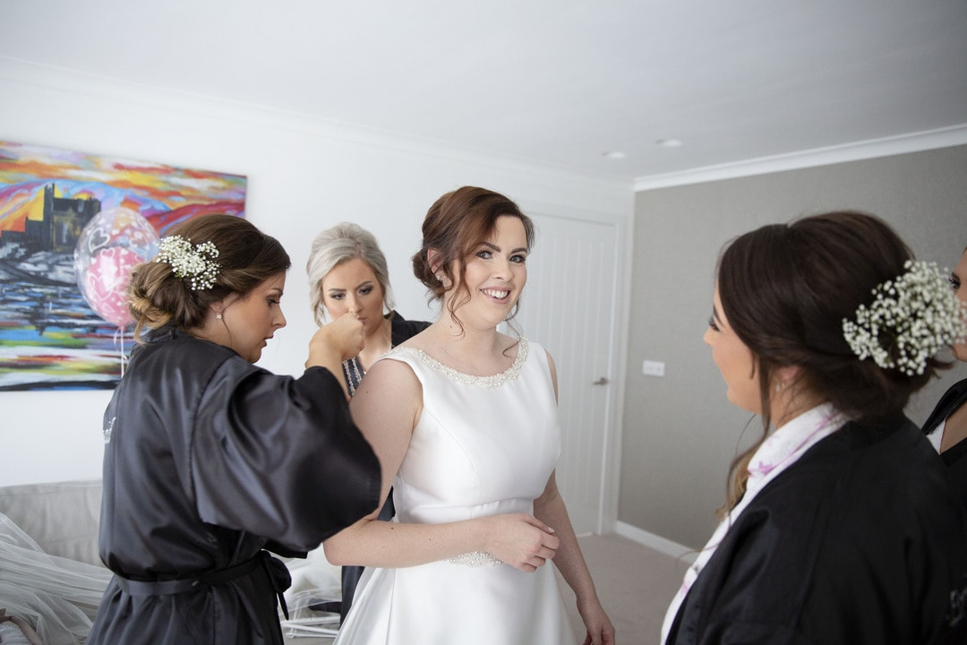 Bride with bridesmaids preparations on wedding day