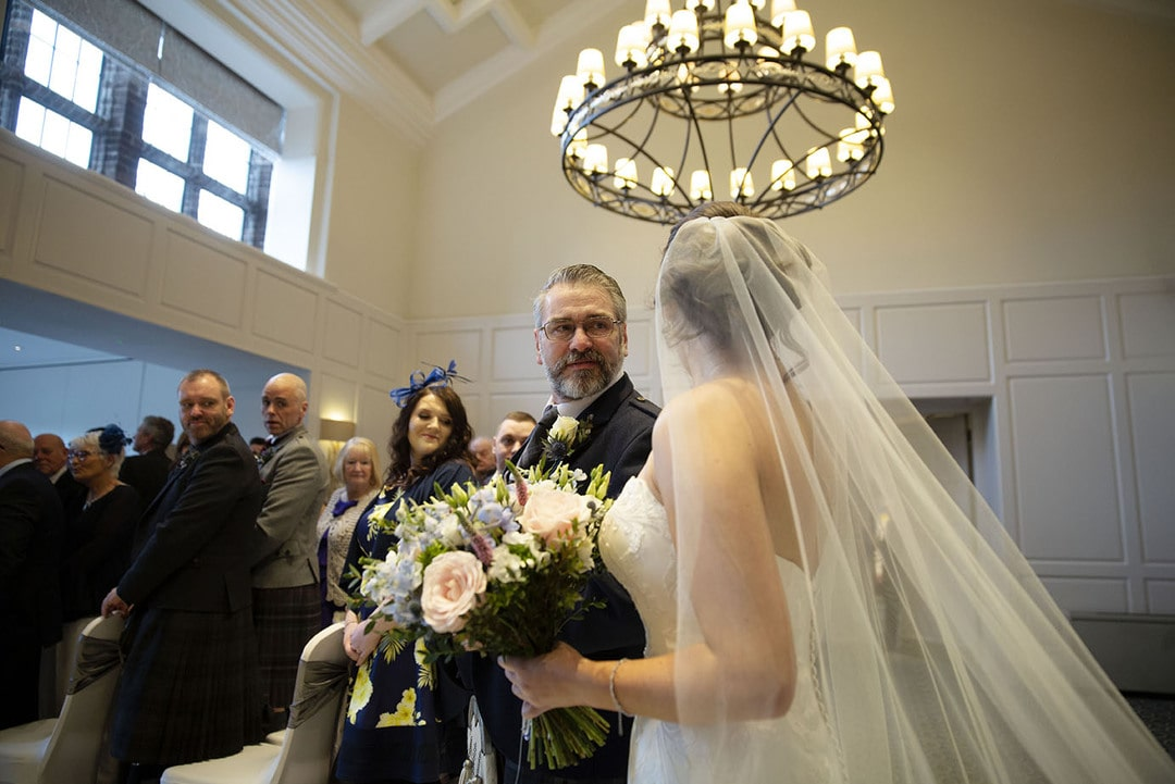 Bride with father on wedding day at Western House Hotel