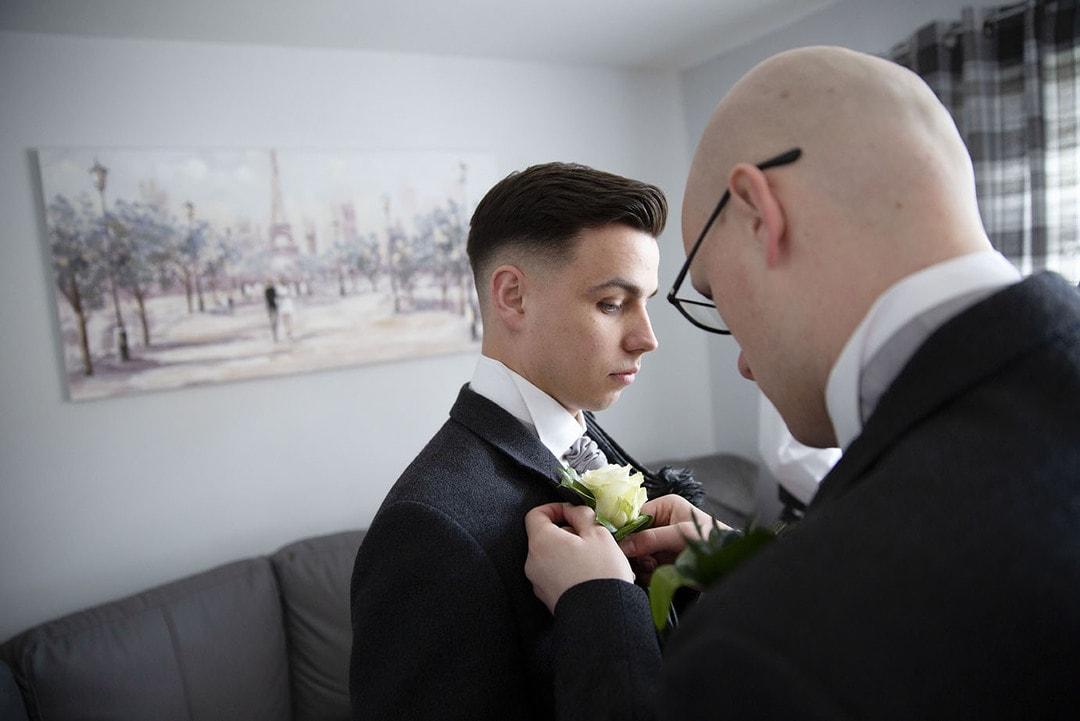 Groom preparations on wedding day