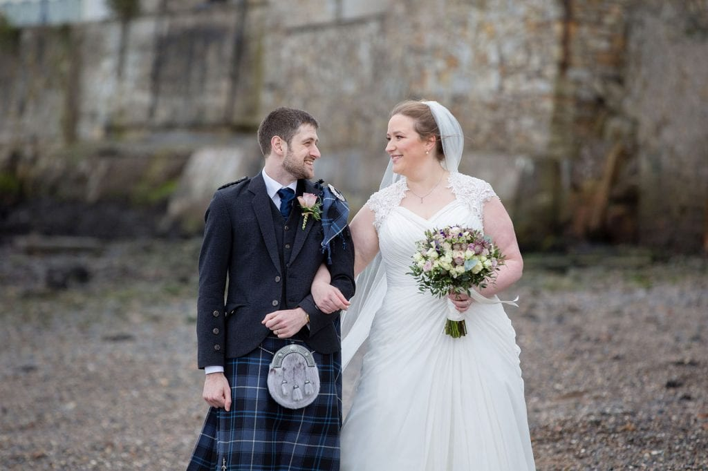 Bride and Groom on wedding day at Orocco Pier in South Queensferry Edinburgh